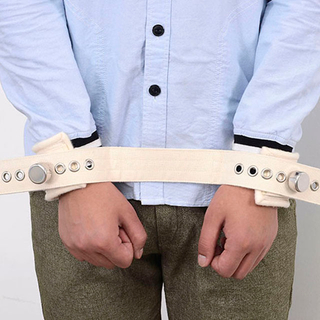 Both hands tie a belt approximately